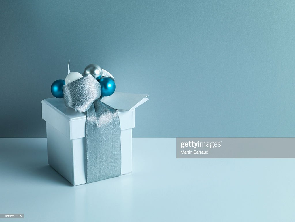 Christmas gift with silver ribbon and wrapping : Stock Photo