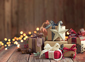 Christmas Eco Friendly Gift Boxes and Decorations on an Old Wooden Background