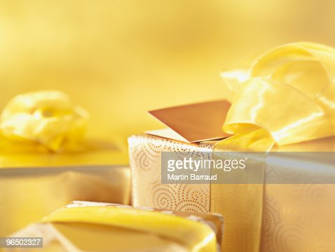 Christmas gifts with gold ribbons : Stock Photo