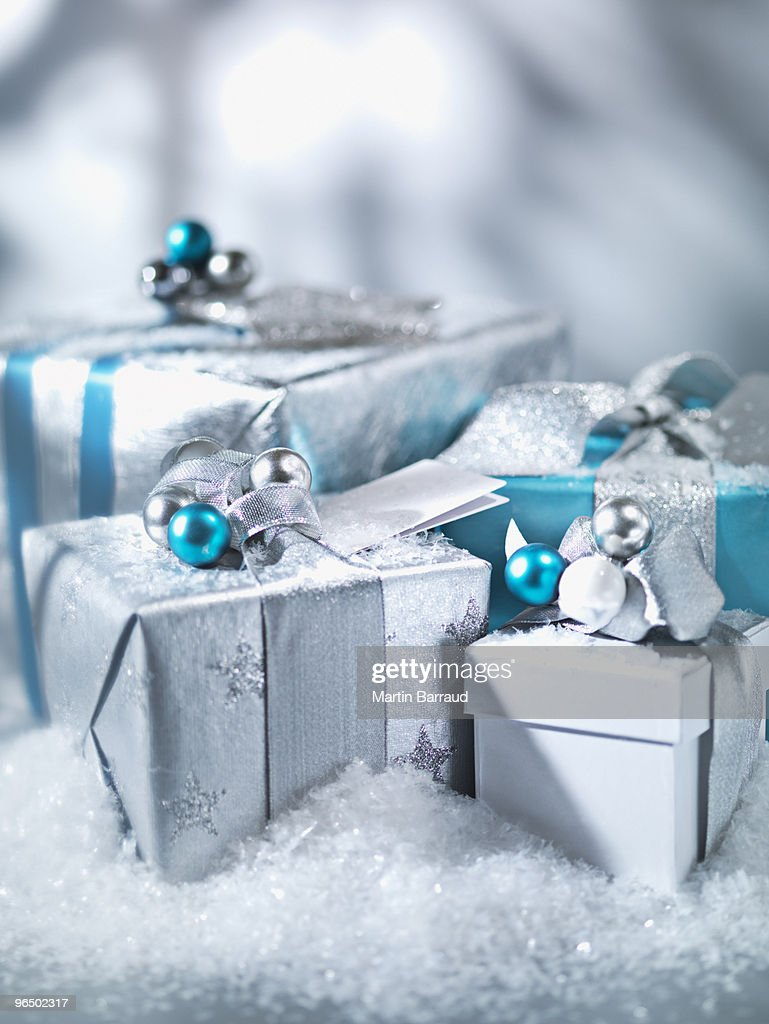 Christmas gifts with silver ribbon : Stock Photo