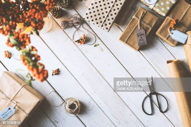 Christmas gifts wrapped with kraft paper on wooden table