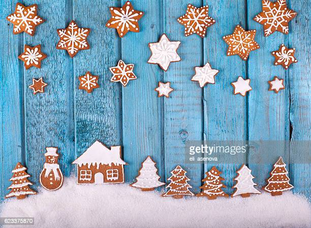 Christmas gingerbread cookies on blue vintage wooden table