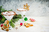 Ideas for Christmas drink, gingerbread martini cold cocktail. with gingerbread cookies, xmas tree and decorations