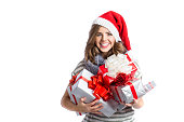 Christmas Santa hat isolated woman portrait. Christmas girl holding a lot of gifts.