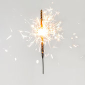 "Christmas glittering  sparklers. decoration lighting element. Festive  Magic sparks lights for holiday poster, birthday or party concept. Xmas decoration lighting element.""n"