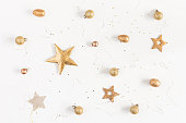 Christmas composition. Christmas golden decorations on white background. Flat lay, top view