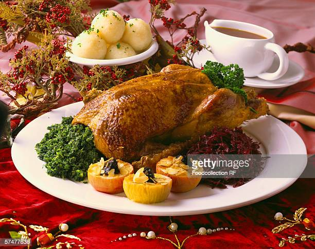 Christmas goose with kale, red cabbage, baked apples, dumplings
