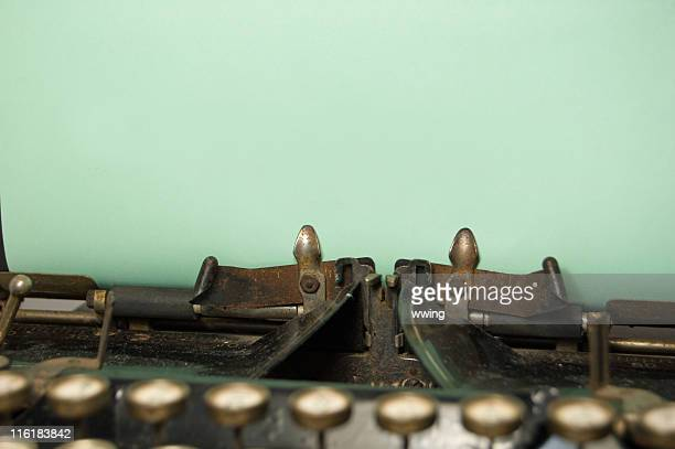 Christmas Green paper on an old typewriter