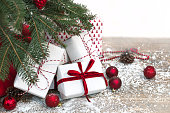 Christmas holiday background. Gifts under christmas tree. Copy space on white.