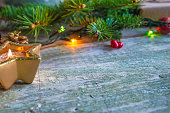 christmas holiday burning candle, fir branches on rustic background with copy space