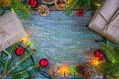 gift boxes, fir branches and christmas decoration on rustic backgroune top view with copy space