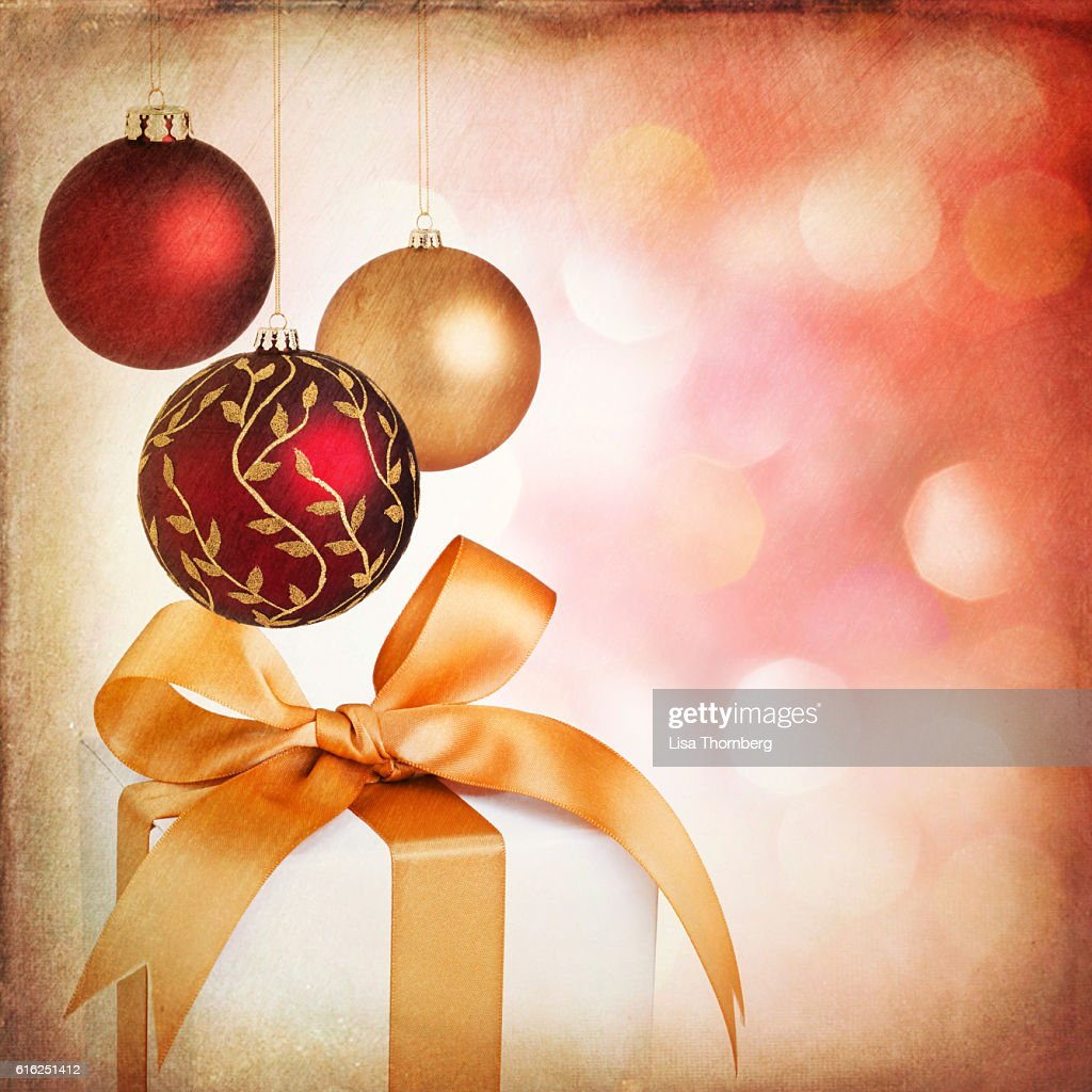 Christmas holiday gifts and baubles with textured Christmas background : Stock-Foto