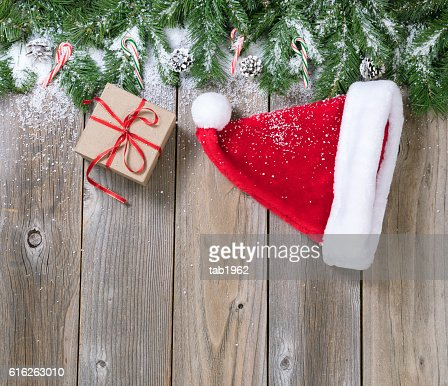 Christmas holiday wooden background with fir branches and snow : Stock Photo