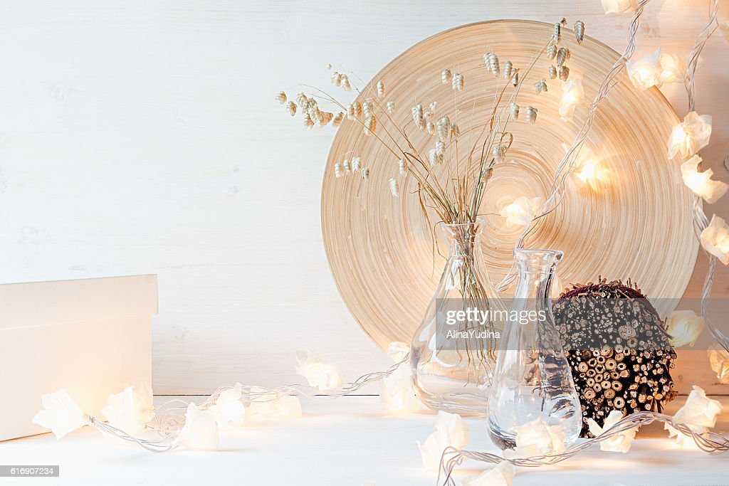 Christmas home decoration with lights on  white wooden background. : Stock Photo