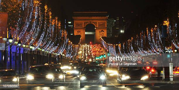 Christmas illuminations are lit along the Champs Elysees avenue on November 23 2010 in Paris France