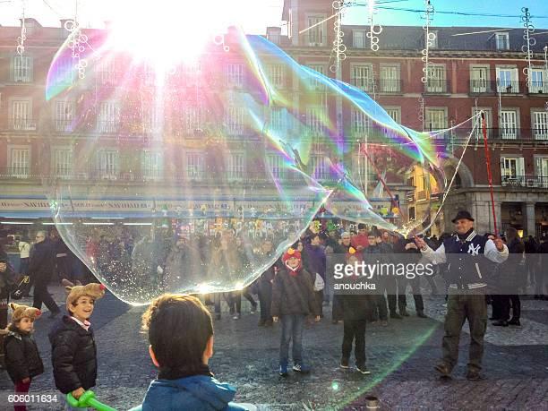 Christmas in Madrid. Giant soap bubble on Plaza Mayor