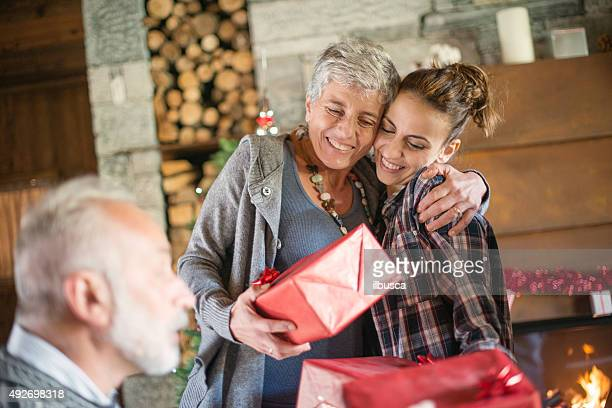 Christmas in mountain house: Family giving presents