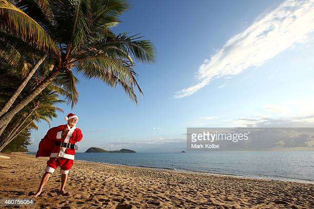 Christmas in paradiseSanta chills out at one of Queensland Australias tropical beaches before the big night Queensland's beaches rank amongst the...
