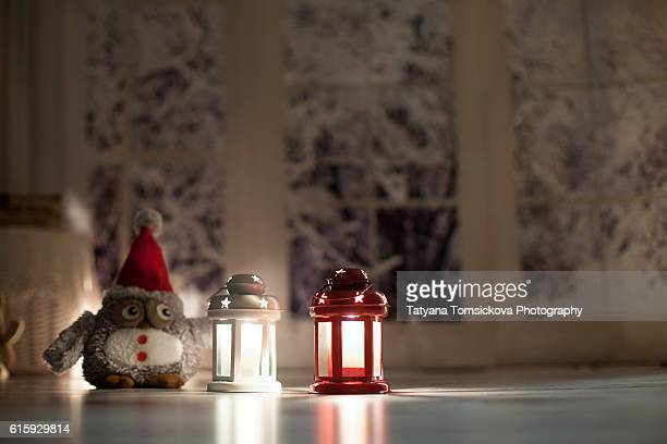 Christmas lantern on a snow background in night