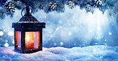 Lantern Glowing In Snowing Scene