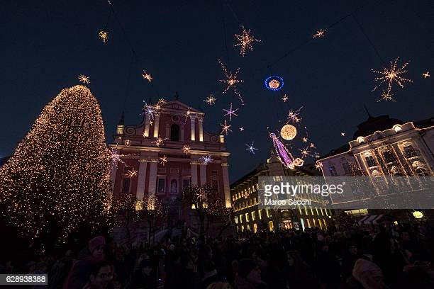 Christmas light and decorations shine on the Franciscan church in the city centre on December 10 2016 in Ljubljana Slovenia The traditional Christmas...