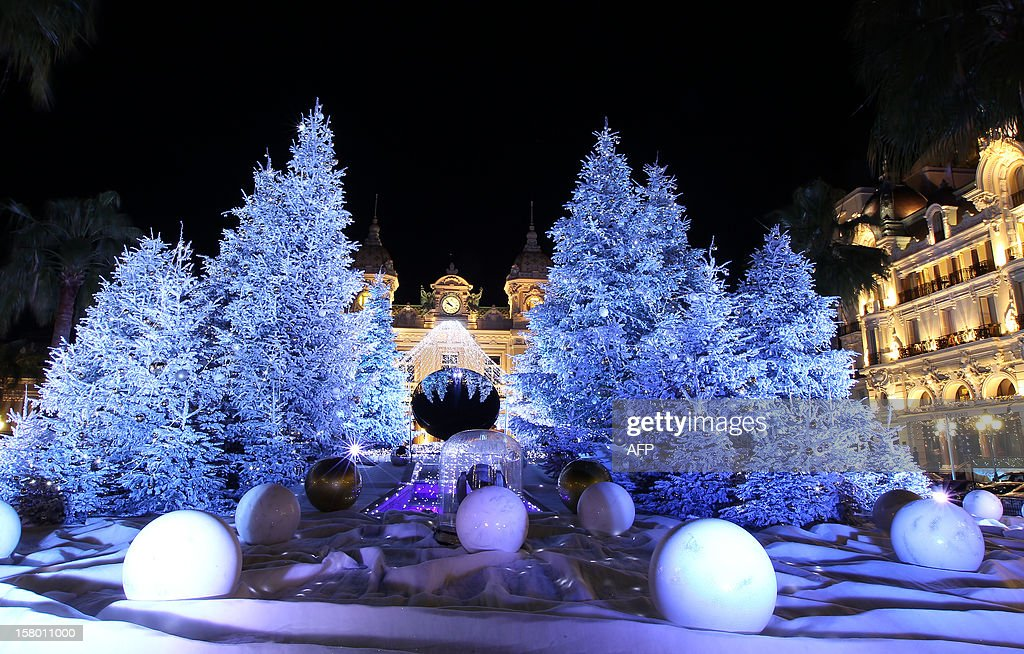 Christmas lights and decorations are seen in front Monte-Carlo's casino late on December 8, 2012 in Monaco. AFP PHOTO / JEAN-CHRISTOPHE MAGNENET