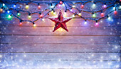 christmas Frame - Red Star And String Lights On Vintage Wooden Plank