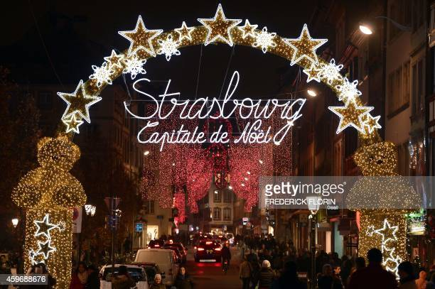 Christmas lights decorate streets in Strasbourg eastern France on November 28 2014 on the opening day of the city's Christmas market the largest and...
