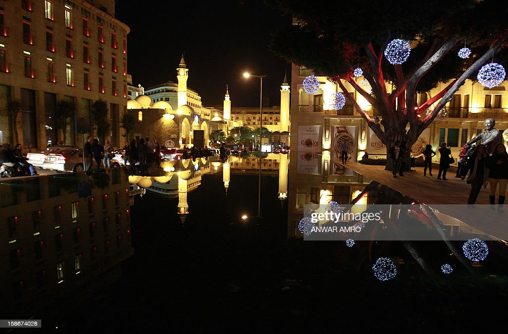 Christmas lights decorate the Samir Kassir garden in the Lebanese capital Beirut on December 23, 2012. AFP PHOTO/ANWAR AMRO