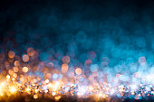Defocused gold and blue christmas lights. Useful background for christmas and general celebration.