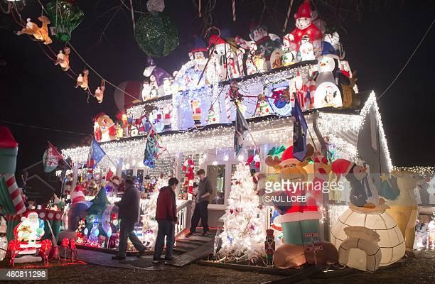 A Christmas lights display is seen on a house in Alexandria Virginia December 23 2014 AFP PHOTO / SAUL LOEB