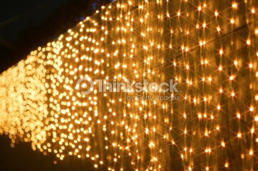 Christmas Lights Hanging Over A Wall Stock Photo | Thinkstock