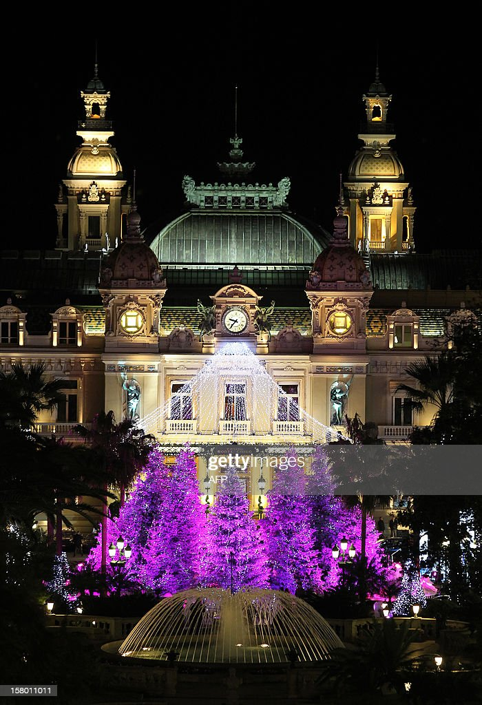 Christmas lights illuminate Monte-Carlo's casino late on December 8, 2012 in Monaco. AFP PHOTO / JEAN-CHRISTOPHE MAGNENET
