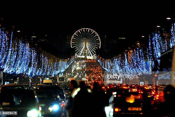 Christmas lights illuminate the famous Avenue des Champs Elysees looking towards the Big Wheel in the Place de la Concorde in Paris on Wednesday Nov...