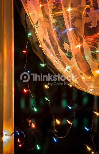 christmas lights in the window stock photo