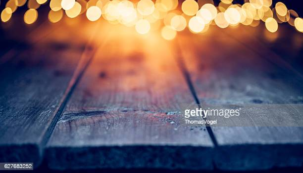 Christmas lights on empty table - Background Defocused Blue wood