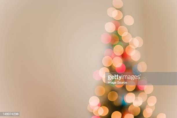 Christmas lights on tree, out of focus