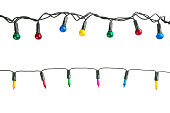 Multi colored Christmas lights isolated on white background.