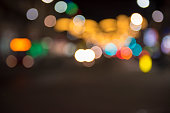 Christmas lights with blur bokeh. Night lights on street. Bokeh light abstract background.