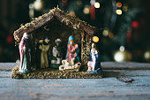 Christmas Manger scene with figurines including Jesus, Mary, Joseph, sheep and magi.