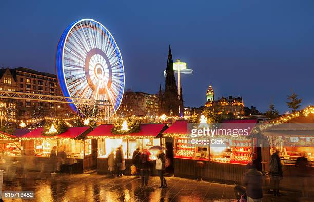 Christmas markets and amusement rides in central Edinburgh, Scotland