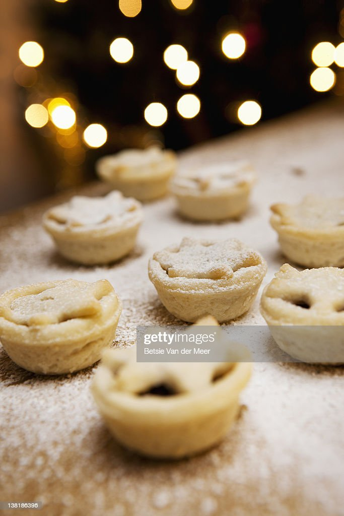Christmas minced pies in front of christmas tree.
