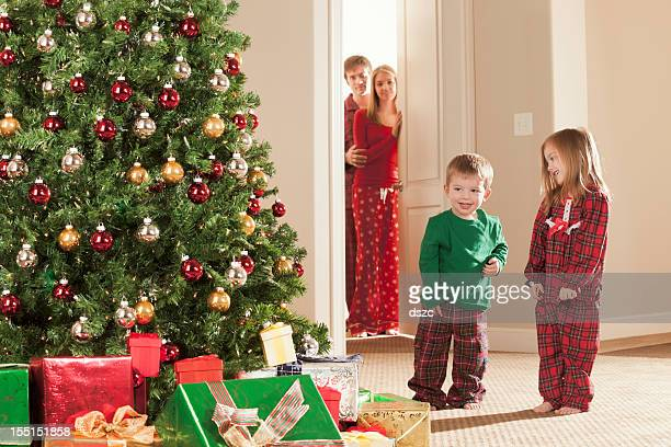 Christmas morning excited children while parents watch