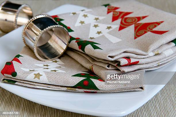 Christmas napkins and napkin rings on table
