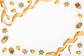 christmas or new year frame composition. christmas decorations in gold colors on white background with empty copy space for text. holiday and celebration concept for postcard or invitation. top view