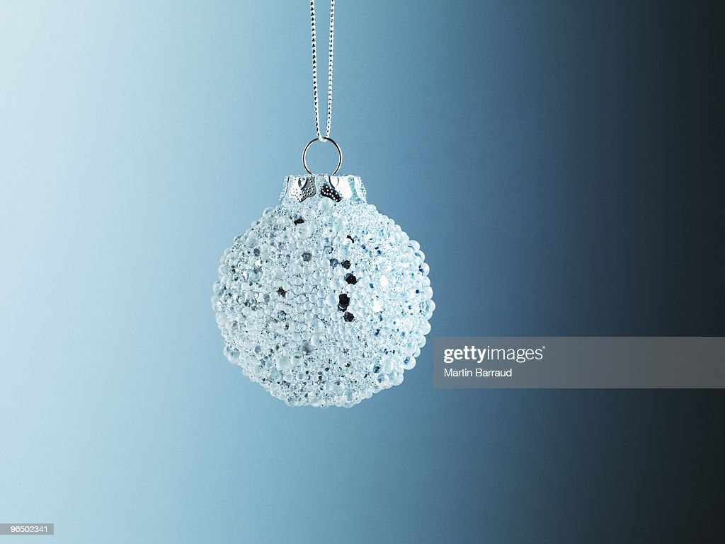 Christmas ornament hanging from string : Stock Photo