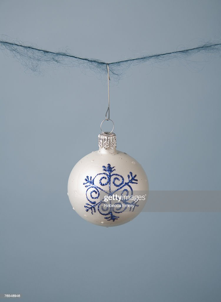 Christmas ornament hanging on string closeup stock photo getty images - String ornaments christmas ...