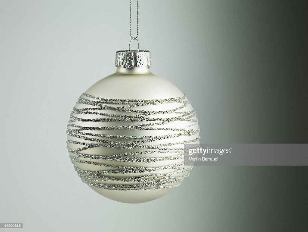 Christmas ornament hanging on string : Stock Photo