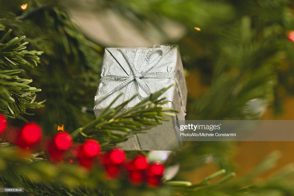 Christmas ornament shaped like a gift : Stock Photo