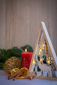 Christmas ornaments and xmas lights with snow, pine tree and candles